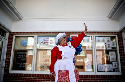 Josh Peckler - Jpeckler@shawmedia.com Dressed as Mrs. Claus Debbie Guida waves to passing cars along West Elm Street in Mchenry before the Toys For Tots Christmas Parade in Sunday, November 18, 2012. After the parade that included almost 800 motorcycle riders toys were collected to be donated to the U.S Marines Toys for Tots.