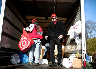 Josh Peckler - Jpeckler@shawmedia.com Earl Westwick of Algonquin stands in a truck while loading up toys after the Toys For Tots Christmas Parade in Mchenry Sunday, November 18, 2012. After the parade that included almost 800 motorcycle riders toys were collected to be donated to the U.S Marines Toys for Tots.