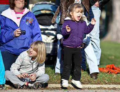 Josh Peckler - Jpeckler@shawmedia.com Madelyn Schmitt, 2 of Mchenry jumps and screams as motorcycles go by during the Toys For Tots Christmas Parade in Mchenry Sunday, November 18, 2012. After the parade that included almost 800 motorcycle riders toys were collected to be donated to the U.S Marines Toys for Tots.