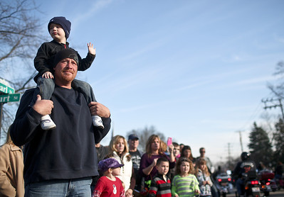 Josh Peckler - Jpeckler@shawmedia.com Ronin Deuser, 4 of Mchenry sits on the shoulders of his father Neal as they watch motorcycles go by during the Toys For Tots Christmas Parade in Mchenry Sunday, November 18, 2012. After the parade that included almost 800 motorcycle riders toys were collected to be donated to the U.S Marines Toys for Tots.