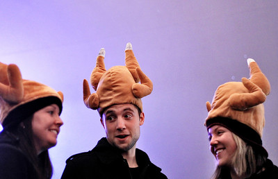 Sarah Nader - snader@shawmedia.com Kelsey Malmstead (left), Patrick Haddox and Sara Haddox, all of St. Charles wear their turkey hats while attending the 30th annual Turkey Testicle Festival at Parkside Pub in Huntley on Wednesday. November, 21, 2012. Admission from the event benefits several local nonprofit organization.