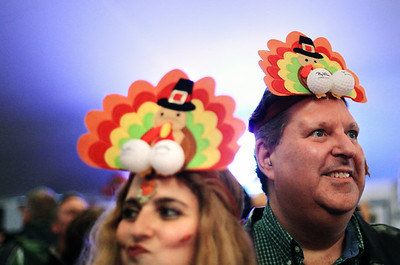 Sarah Nader - snader@shawmedia.com Decked out in turkey hats Sharone Kaplen (left) and Adam Haus, both of Chicago, take part in the 30th annual Turkey Testicle Festival at Parkside Pub in Huntley on Wednesday. November, 21, 2012.