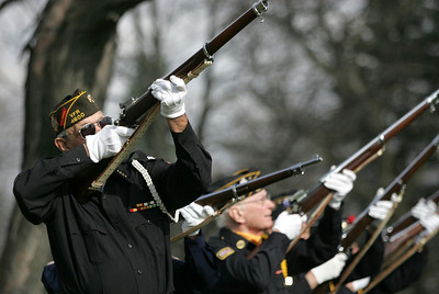 Monica Maschak - mmaschak@shawmedia.com A combined Honor Guard of McHenry fires shots into the air as a salute at the VFW Post 4600 on Veterans Day Sunday, November 11, 2012.  Members of the Polish Legion of American Veterans Post 188, Veterans of Foriegn Wars Post 4600 and the American Legion Post 491 participated in the combined ceremony for family and community members.