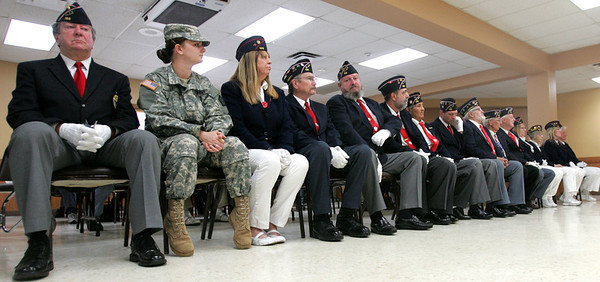 Monica Maschak - mmaschak@shawmedia.com Members of the Polish Legion of American Veterans Post 188, Veterans of Foreign Wars Post 4600 and the American Legion Post 491 listen to speakers and presentations during a combined Veterans Day ceremony at the VFW Post 4600 in McHenry on Sunday, November 11, 2012.