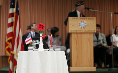 Monica Maschak - mmaschak@shawmedia.com A lone table and chair was set in the middle of the floor to symbolize the POW-MIA who are no longer with us.  The Veterans of Foreign Wars Post 4600 held a combined ceremony with the Polish Legion of American Veterans Post 188 and the American Legion Post 491 for Veterans Day on Sunday, November 11, 2012. Commander Cliff Schmidt from the Polish Legion of American Veterans was this year's master of ceremonies.