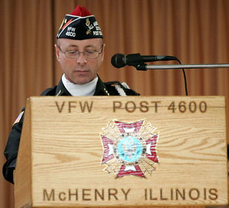 Monica Maschak - mmaschak@shawmedia.com Veterans of Foreign Wars Post 4600 Commander Ron Reber speaks to the veterans and community members that filled the VFW for a Veterans Day ceremony in McHenry on Sunday.