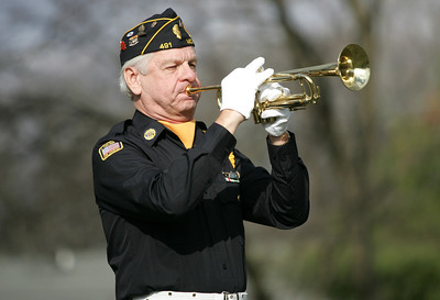 Monica Maschak - mmaschak@shawmedia.com American Legion Post 491 Bugler Ron Bykowski plays Taps during a rifle salute at a Veterans Day ceremony in McHenry on Sunday.
