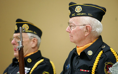 Monica Maschak - mmaschak@shawmedia.com American Legion Post 491's Bill Bacon (left) and Roger Lasko listen to speeches given at a combined Veterans Day ceremony at the VFW Post 4600 in McHenry on Sunday.