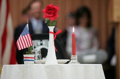 Monica Maschak - mmaschak@shawmedia.com A lone table and chair was set in the middle of the floor to symbolize the POW-MIA who are no longer with us.  The Veterans of Foreign Wars Post 4600 held a combined ceremony with the Polish Legion of American Veterans Post 188 and the American Legion Post 491 for Veterans Day on Sunday, November 11, 2012.