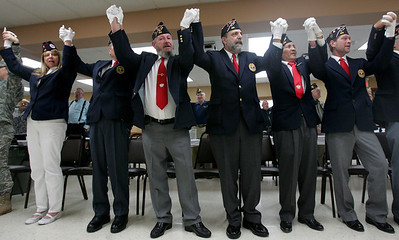 Monica Maschak - mmaschak@shawmedia.com Members of the Polish Legion of American Veterans Post 188, Veterans of Foreign Wars Post 4600 and the American Legion Post 491, along with family and community members, hold hands and sing along with Sally Roth to God Bless the U.S.A. during a combined Veterans Day ceremony at the VFW Post 4600 in McHenry on Sunday, November 11, 2012.