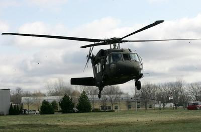 Monica Maschak - mmaschak@shawmedia.com An Army Black Hawk UH-60A takes off from a field in front of Marengo Community High School after a Veterans Day Commemoration ceremony on Monday.
