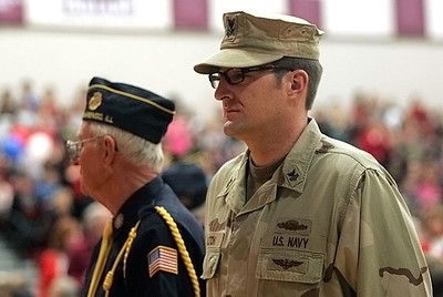 Monica Maschak - mmaschak@shawmedia.com Navy Veteran Patrick Dalton, as well as other Veterans and military members, stood for the presentation of the flag during a Veterans Day Commemoration assembly at Marengo Community High School on Monday, November 12, 2012.