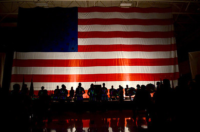 Monica Maschak - mmaschak@shawmedia.com A giant American Flag was hung in the Marengo Community High School's gym for a Veterans Day Commemeration they were hosting on Monday, November 12, 2012. Students, Veterans and community members all packed into the gym to watch the ceremony where students performed musical numbers and Veterans of the Air Force, Army, Navy, Marines and Coast Guard were named individually.