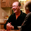 Dave Rushton, pastor of hope Community Church in St. Charles, laughs during a friendly card game with Eddie Smith (not pictured) and Dave White (far right) at his home. Rushton was diagnosed with Parkinson's disease a few years ago.(Sandy Bressner photo)