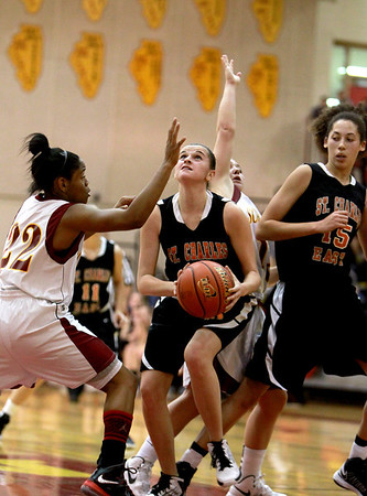 Paige Jordan of St. Charles East shoots the ball during their Schaumburg Thanksgiving Girls Basketball Tournament game against Schaumburg Tuesday night.(Sandy Bressner photo)