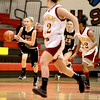 St. Charles East's Katie Claussner dribbles down court during their Schaumburg Thanksgiving Girls Basketball Tournament game against Schaumburg Tuesday night.(Sandy Bressner photo)
