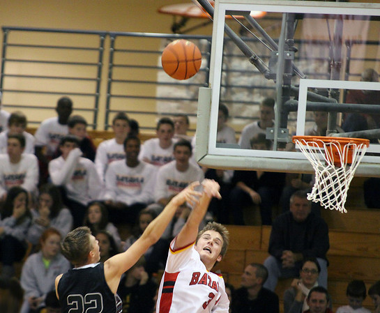 Jeff Krage -- For the Kane County Chronicle<br /> Batavia's Zach Strittmatter blocks a shot by Kaneland's Dan Miller during Wednesday's game at the 37th annual Windmall City Classic.<br /> Batavia 11/21/12