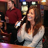 Jeff Krage - For the Kane County Chronicle<br /> Tiffany Casiello of St. Charles enjoys a drink Friday night at Alley 64.<br /> St. Charles 11/16/12