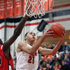 Jeff Krage -- For the Kane County Chronicle<br /> St. Charles East's Kendall Stephens looks for a shot around St. Joseph's Paul Turner during Friday's game in the 54th annual Thanksgiving Tournament at St. Charles East High School.<br /> St. Charles 11/23/12