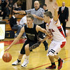 Jeff Krage -- For the Kane County Chronicle<br /> Kaneland's Dan Miller is closely guarded by Batavia's Dan Albrecht during Wednesday's game at the 37th annual Windmall City Classic.<br /> Batavia 11/21/12