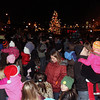 Jeff Krage -- For the Kane County Chronicle<br /> A crowd gather as the Christmas tree is lite during Sunday's Celebration of Lights on the Batavia River Walk.<br /> Batavia 11/25/12