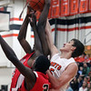 Jeff Krage -- For the Kane County Chronicle<br /> St. Charles East's Dan Wilkerson, right, battles for a rebound during Friday's game against St. Joseph in the 54th annual Thanksgiving Tournament at St. Charles East High School.<br /> St. Charles 11/23/12