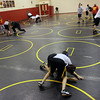 Jeff Krage -- For the Kane County Chronicle<br /> Batavia wrestling coach Scott Bayer, left, works with a wrestler during Monday's practice. <br /> Batavia 11/19/12