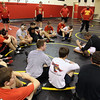 Jeff Krage -- For the Kane County Chronicle<br /> Batavia wrestling coach Scott Bayer instructs wrestlers on proper technique during Monday's practice. <br /> Batavia 11/19/12