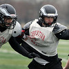 Jeff Krage – For the Kane County Chronicle<br /> Aurora Christian defensive end Jonah Walker, right, runs a drill during Wednesday's football practice.<br /> Aurora 11/7/12
