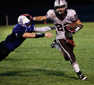 Candace H. Johnson Prairie Ridge's Brent Anderson evades the tackle by Lakes' Nick Battaglia in the third quarter at Lakes Community High School in Lake Villa.