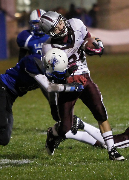 Candace H. Johnson Lakes' Charles Hudson tackles Prairie Ridge's Brent Anderson in the first quarter at Lakes Community High School in Lake Villa.