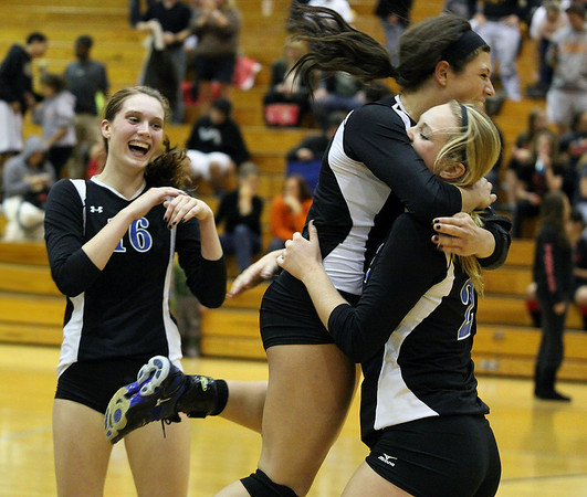 Jeff Krage – For Shaw Media<br /> Geneva's Hannah Lanasa, left, laughs as Courtney Caruso jumps on Maddie Schmidt  after the Vikings won the IHSA class 4A Regional Championship on Thursday at Addison Trail High School by defeating Batavia.<br /> Addison 10/31/13