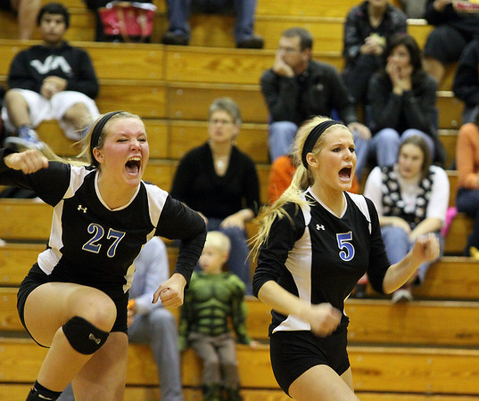 Jeff Krage – For Shaw Media<br /> Geneva's Taylor Marmitt, left, and KyleyThompson celebrate Thursday after winning the IHSA class 4A Regional Championship at Addison Trail High School by defeating Batavia.<br /> Addison 10/31/13
