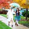 """Marja Neylon (left) of Geneva and Amy Graham of Aurora walk down James Street in downtown Geneva dressed as  a """"Spa Woman"""" and fairy, respectively, Thursday afternoon."""