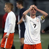 Jeff Krage – For Shaw Media<br /> St. Charles East's Jacob Sterling holds his head after the Saints fell 1-0 to Lake Park in Saturday's IHSA class 3A sectional championship at Schaumburg High School.<br /> Schaumburg 11/2/13