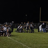 Kaneland Knights watch as medics assist Brandon Bishop after an injury suffered after a punt return at Kaneland High School in Maple Park, IL on Friday, November 01, 2013 (Sean King for Shaw Media)