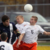 Jeff Krage – For Shaw Media<br /> St. Charles East's Kyle McLean, right, and Kevin Heinrich go up for a header against Lake Park's Mike Catalano during Saturday's IHSA class 3A sectional championship at Schaumburg High School.<br /> Schaumburg 11/2/13