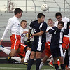 Jeff Krage – For Shaw Media<br /> St. Charles East's players, including Cooper Macek, left, and Zach Manibog, right, go up for a corner kick late in the second half of Saturday's IHSA class 3A sectional championship against Lake Park at Schaumburg High School.<br /> Schaumburg 11/2/13