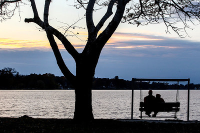 Sarah Nader- snader@shawmedia.com Bob Pegler of Lakewood (left) and his wife, Fran Pegler,  watch the sunset at Main Beach in Crystal Lake Monday, November 4, 2013.