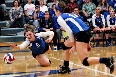 Sarah Nader- snader@shawmedia.com Lakes' Maddie Demo dives for the ball during Tuesday's Class 3A Burlington Central Sectional semifinal against Burlington Central in Burlington November 5, 2013.