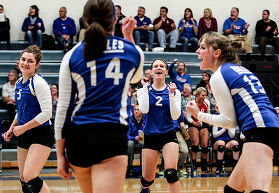 Sarah Nader- snader@shawmedia.com Lakes' Lisa Buehler (center) celebrates a point during Tuesday's Class 3A Burlington Central Sectional semifinal against Burlington Central in Burlington November 5, 2013.