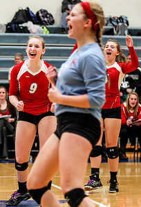 Sarah Nader- snader@shawmedia.com Marian Central's Alex Kaufmann (left) celebrates after winning Tuesday's Class 3A Burlington Central Sectional semifinal against Regina Dominican in Burlington November 5, 2013. Marian Central won, 2-0.