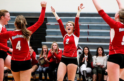 Sarah Nader- snader@shawmedia.com Marian Central's Sarah Hendle (center) celebrates with her teammates after winning Tuesday's Class 3A Burlington Central Sectional semifinal against Regina Dominican in Burlington November 5, 2013. Marian Central won, 2-0.