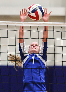 Sarah Nader- snader@shawmedia.com Lakes' Abbey Buehler jumps to block the ball during Tuesday's Class 3A Burlington Central Sectional semifinal against Burlington Central  in Burlington November 5, 2013.