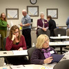 Barbara Riebe (foreground) and Denise Krecker, both of St. Charles, look over study materials during a training session for Fox Valley Court Watch volunteers at the St. Charles Police Department Wednesday morning.