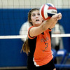 St. Charles East's Carly Jimenez returns the ball during their 19-25, 22-25 Geneva Sectional semifinal loss to St. Charles North Tuesday.