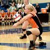 Chloe Rojas of St. Charles East digs the ball during their 19-25, 22-25 Geneva Sectional semifinal loss to St. Charles North Tuesday.