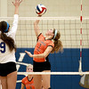 St. Charles East's Meagan Smith goes up for a kill during their 19-25, 22-25 Geneva Sectional semifinal loss to St. Charles North Tuesday.