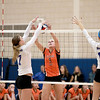 Megan Schildmeyer (9) tries to get the ball over the net during their 19-25, 22-25 Geneva Sectional semifinal loss to St. Charles North Tuesday.