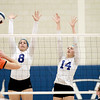 St. Charles North's Claire Anderson (8) and Emily Carroll (14) go up for a block during their 25-19, 25-22 Geneva Sectional semifinal win over St. Charles East Tuesday.